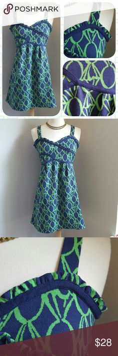 Lilly Pulitzer Ring Pop and Ruffle Dress In a navy and green 'jacquard-like' print, this pretty LP mini features a ruffled bodice, accent ribbons, and a hidden zipper with hook and eye closure. Pair it with some tights and a jacket you brighten up your winter mornings!  Size 0. Excellent condition. Lilly Pulitzer Dresses Mini
