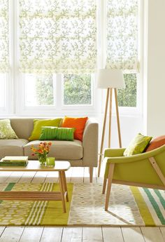 Bring the outside in with vibrant shades of leaf green. Touches of tangerine will lift the scheme while white walls and light-wood furniture provide the perfect backdrop. Photography: Mark Scott. Find more living room ideas at housebeautiful.co.uk