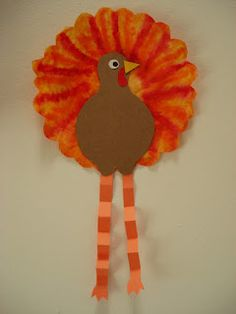 Coffee Filter Turkey - Use washable markers on the filter and lightly dab with a wet paintbrush to blend.