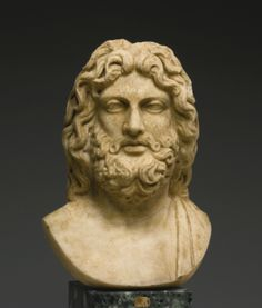 A Marble Head of Zeus, Roman Imperial, late 1st/2nd Century A.D., on an 18th Century bust