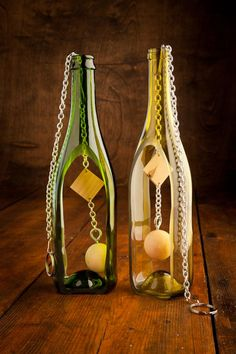 Wine bottle wind chimes. Diy? Cut wine bottle with tile saw/diamond blade for glass, chain and wood bead from craft store