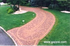 Circular driveway in east Islip New York. Paving stones used for this driveway, are Nicolock roman sante euro circle and roma st Driveway Border, Circular Driveway, Driveway Landscaping, Driveway Ideas, Landscaping Ideas, East Islip, Paving Stones, Circle Design, Backyard