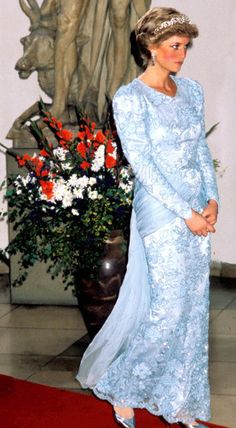 Diana wore this icy blue gown several times in 1987. She wore it in Portugal, and in Qatar while on a tour of the Gulf States, and in Munich, Germany. After that it was altered into a strapless gown that was worn twice in 1990 including an official visit to Nigeria.