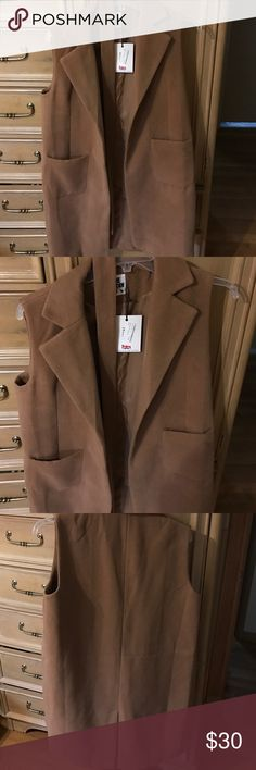 BNWT camel sleeveless belted coat 🍁 Great sleeveless belted jacket. Warm! This jacket is the perfect length for fall, coming an inch or so below the knee (I'm 5'3) brand new with tags never worn. This is an essential fall jacket! Size 8. Don't miss! the rockin rev Jackets & Coats
