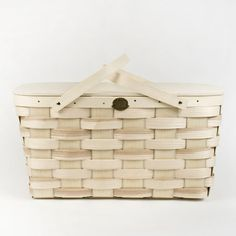 This classic picnic basket is made by a New Hampshire company that has produced baskets for more than 150 years. Handmade from Appalachian white ash - the same hardwood that baseball bats are made from - it is generously sized with extra height to vertically store most wine bottles. The hinged lid provides easy access, with double swing carrying handles. The finish is natural and over time will darken slightly and gain more character. Makes an excellent tote for outings to the farmer's…