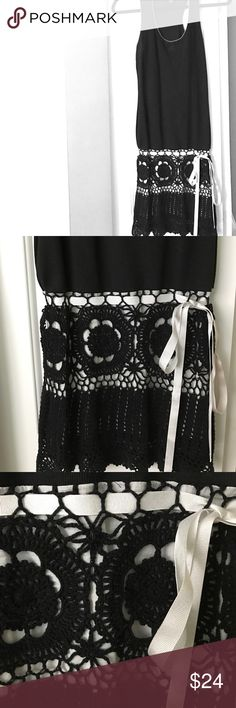 HOST PICK 💝 Victoria's Secret Black Dress Crochet This was purchased from Victoria's Secret catalogue and is a ModaInternational label. It is black stretch cotton with white piping around the shoulders and neck, and it has a really pretty crochet skirt with white underlay and a white ribbon tie. Size XS. Very gently pre-loved 💕 Victoria's Secret Dresses Mini