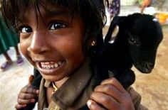 This is too cute! Little girl carries her baby goat on her back. www.thesmokinggoat.com