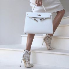 "Up Close and Stylish (@upcloseandstylish) ""Winter whites - #Marni dress, #DolceGabbana lace booties and #Hermès #KellySellier32."""