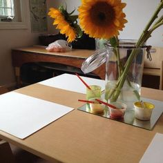An invitation for toddlers to paint sunflowers