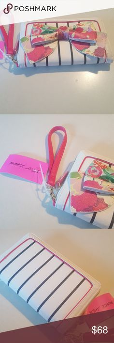 Betsey Johnson bow wallet with strap Floral bow 5.5 by 9 in..hot pink strap..lots slots for cards Betsey Johnson Bags Wallets
