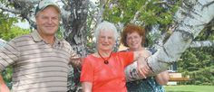 Reed, left, Marjorie and Kathy Wolfe will host a celebration July 7 to recognize 130 years of Wolfes and Rutherfords farming near Tarbolton, Man. The Wolfes expect about 100 relatives and friends to attend the event, which coincides with Marjorie's 90th birthday.