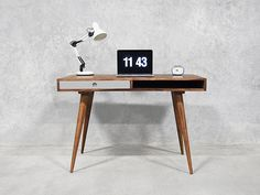 A desk that makes working pleasurable, paying tribute to mid century and modern Scandinavian design.