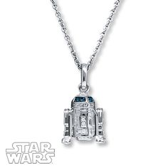 This delightful Star Wars™ necklace features R2-D2 styled in sterling silver and decorated with blue and white diamonds. The pendant suspends from a 19-inch cable chain that secures with a lobster clasp. Blue diamonds are treated to permanently create the intense blue color. © & ™ Lucasfilm Ltd.