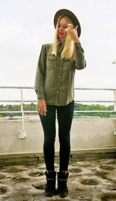 Shop this look on Lookastic:  https://lookastic.com/women/looks/olive-button-down-blouse-black-skinny-jeans-black-high-top-sneakers-olive-hat/3462  — Olive Wool Hat  — Olive Button Down Blouse  — Black Skinny Jeans  — Black Leather High Top Sneakers