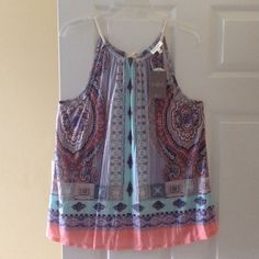 Beautiful and new Anthropologie halter top! Spring colors. Soft and comfortable. Pair along with your favorite capris or shorts! Anthropologie Tops Blouses