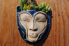 Ceramic face planter garden art mask wall planter head planter This large life-sized ceramic face planter will turn your tiny shallow rooted plants into a work of art. This is a ceramic wall planter made out of stoneware high fired clay. This garden pocket is a hanging hole at the top for easy display and a drainage hole for happy plants. What a wonderful way to create a wonderful garden atmosphere indoors and outside. This garden wall planter is a delightful gift for gardeners . This…