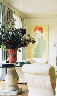 Vogue Living....<3ing the gi-normous art, incredible oval table & chic white seating!