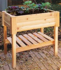 wood deck planter...save your back and uses less soil than tiered standing planters...hmmm