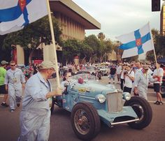 With Finnish battle flags flying, the Wandering Troubadours of Finland accompanied their 1932 Auburn across the finish line in San Bernardino, Calif., an overnight stop on the Great Race.