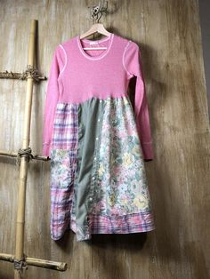 A unique up cycled dress/tunic, beautiful soft pink. Romantic and so easy to wear. The top is a lightweight cotton knit and bottom cotton pieces of fabric. Its funky and fun and hangs beautifully great alone or over your favorite leggings, Approximate measurements Bust area - 19