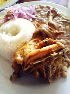 Cabrito a la norteña (Peruvian dish)  This is a delicious dish, is made from goat, beans and rice. It may be accompanied by a sauce made with onion, pepper and lemon.