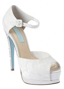 """Turn up the heat with these sizzlinglace high heel embellished pumps!  Heel height: 5 1/2"""" with 1 1/34"""" Platform. (Comparable to a 3 3/4"""" heel).  Adjustable strap with buckle closure.  Textile upper/synthetic lining and sole.  Imported."""