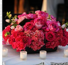 Pink and black centerpiece. Love the choice of flowers, such a full and lovely look!