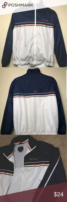 Nike Jacket Size Medium (8-10) Nike Jacket Size Medium 8-10   Front full zip jacket. Colors navy blue, orange, and white. Slight fading on the jacket from white-yellow. A few stains on the front of the jacket near the zipper. A yellow stain on the mid right chest. A few black stains on the inner left flap near the zipper. The white paint is also wearing off from the zipper.   Arm sleeve measurement - 60 cm. Nike Jackets & Coats Windbreakers