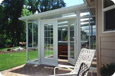 Simple Sunroom. I'd use it for a garden instead of a hottub.