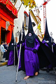 Procession of over 2,000 people during Semana Santa in Sevilla, Spain 2012.  Notice the bare feet.  Do some penitents still walk or crawl across broken glass to repent for their sins?  (They still do such things in Bolivia, note the photo of wire being removed from penitent's foot in 2012.)