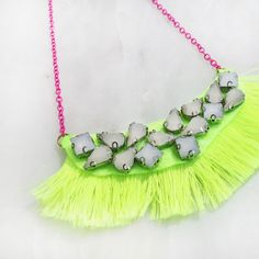 Bohemian Jewelry by Jacques and Sienna launchest the newest design Bib Necklace that makes a boho statement. The necklace is completely fringed with hot pink fine tassels and centred w Bohemian Jewelry, Luxury Jewelry, Kids Jewelry, Jewelry Making, What Are Crystals, Girls Necklaces, Party Shop, Party Accessories, Necklace Designs