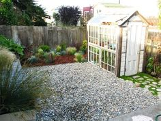 I don't love the layout, but I could see doing the three ideas here in our backyard: mulch covered planting bed, grassy/moss with stones, and a stone-only area
