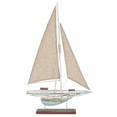 """Weathered wood sailboat decor. Product: Sail boat décorConstruction Material: Quality natural wood and fabricColor: Tan, distressed white and rustFeatures: Antique lookDimensions: 22"""" H x 14"""" W"""