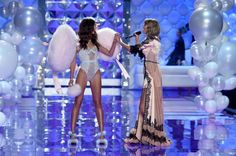 Model Lily Aldridge (L) and singer Taylor Swift are seen on the runway during the 2014 Victoria's Secret Fashion Show at Earl's Court Exhibition Centre on December 2, 2014 in London, England.