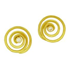 """Gold Diamond Swirl Earrings  Barbara Heinrich's 16mm 18K gold and diamond swirl earrings sit on the ear, the matte and polished gold curled on the lobe, with a diamond set at center, 0.16 cts total weight, 5/8"""" diameter."""