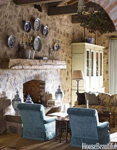Stone walls and large ceiling beams add a romantic atmosphere to this vacation home. Designed by Cathy Kincaid.   - HouseBeautiful.com
