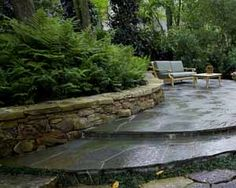 Boulder walls are a great element to use in garden design. They can be a short as one foot in height. Small boulders are simply lined up on a row with smaller rocks filling in the gaps between the larger stones. Walls like this can be borders, or they can be used to divide a large garden into zones.