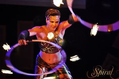 Kissed by stardust from the rings of Saturn, Vivian became Spiral and was thereby inspired to create a unique, mesmerizing style of hoop dance.