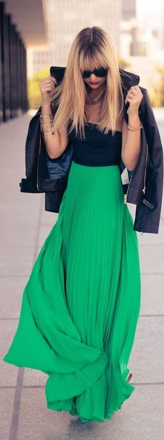Shop this look on Lookastic:  http://lookastic.com/women/looks/biker-jacket-cropped-top-maxi-skirt-sunglasses-necklace-bracelet/8743  — Black Sunglasses  — Gold Necklace  — Gold Bracelet  — Black Cropped Top  — Black Leather Biker Jacket  — Green Pleated Maxi Skirt