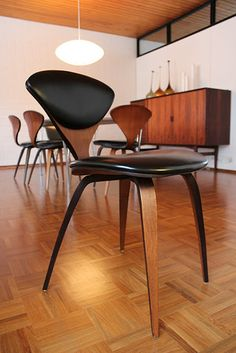 Norman Cherner designed this chair for Plycraft,1958, with plywood walnut veneer and vinyl naugehyde upholstery.