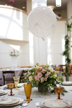 hot air balloon centerpiece - photo by Alexa's Photography http://ruffledblog.com/candy-colored-wedding-inspiration-in-charlotte #weddingideas #centerpieces