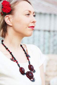 Black and red statement necklace made for glass beads, seed beads, czech glass beads, natural leather on the beck side and metal detail.  Perfect