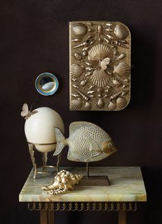 Make It Your Own: Erica Domesek created a grotto jewelry box using shells and plastic insects in honor of the natural curiosities collections that were popular in Victorian homes.
