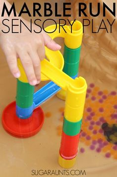 Put the marble run in the water table with water beads for summer sensory and fine motor fun with the kids!