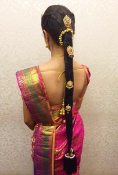 Traditional South Indian bride's bridal braid hairstyle. Hairstyle by Swank Studio. Find us at https://www.facebook.com/SwankStudioBangalore  #Saree #Blouse #Design