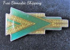 Stop by and visit us, where the old can be new and the new can be old. Vintage Art Deco revival brooch. An inspired Pierre Bex with the popular 1930 color green and beautiful gold inlay. This may have been produced in the 1980's with its clean... #etsyshop #vintage #antiques #upcycled #handmade #vintagedecor #vintagejewelry #freeusshipping #4rloveofoldandnew