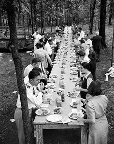 Enjoying a meal of pit-cooked barbeque with friends and family, Braswell Plantation near Rocky Mount, NC, September 1944
