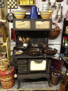 Antique cast iron woodburning cook stove