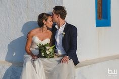 couple, in love, destination wedding, moments, summer, bouquet, flowers, amazing, special day, kiss, Santorini
