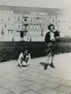 On June 12, 1942, Anne Frank receives a diary for her thirteenth birthday (which lays behind her on the sidewalk). Anne is pictured here with her friend (standing) at the place she used to live before she had to go underground.
